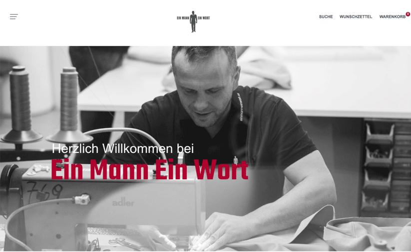 Ein Mann Ein Wort Onlineshop Banner, dass Mann bei der Arbeit an einer Nähmaschine zeigt.